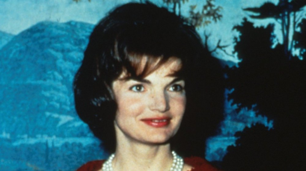 Jackie O wearing a red dress, up-close