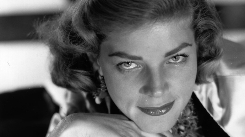 Lauren Bacall smiling seductively