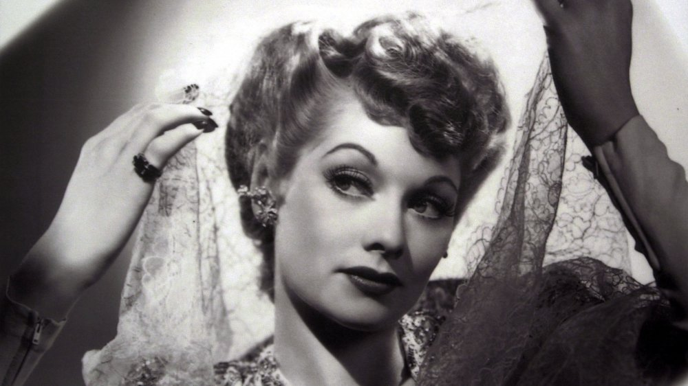 A vintage photo of Lucille Ball holding a veil