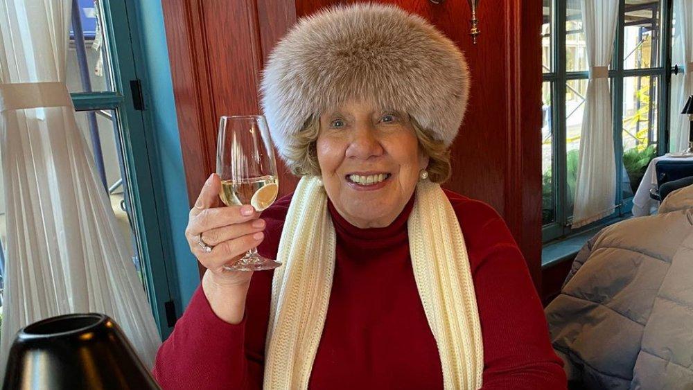 Nanny Faye Chrisley raising a glass of wine