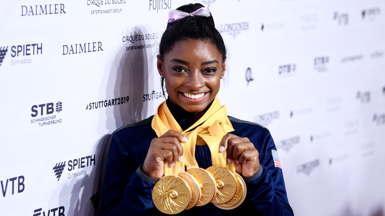 Simone Biles with gold medals
