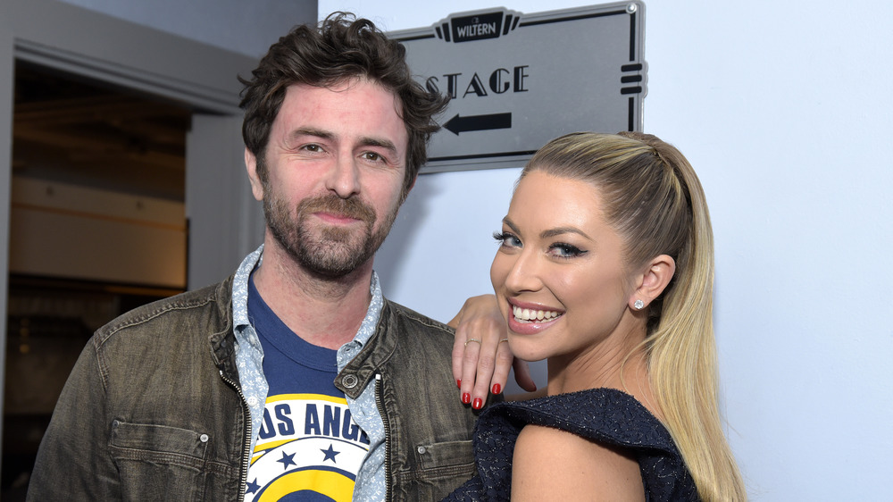 Beau Clark and Stassi Schroeder at a live Straight Up with Stassi show