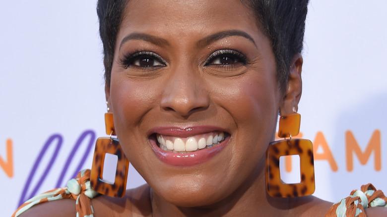 Tamron Hall smiling, wearing earrings