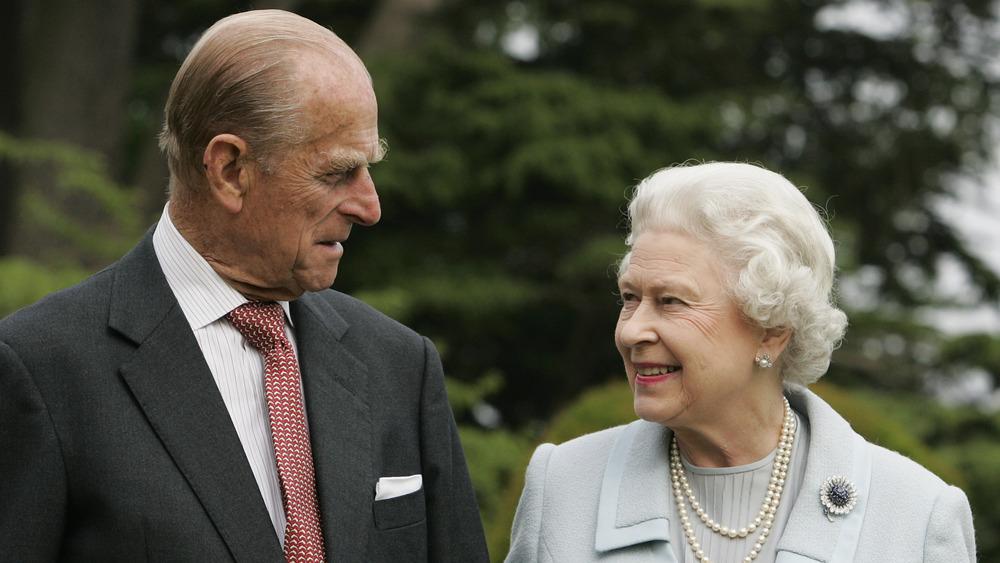 Queen Elizabeth and Prince Philip in a garden
