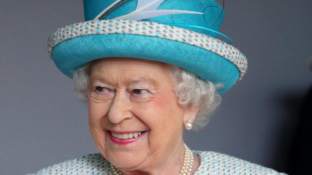Queen Elizabeth in blue hat