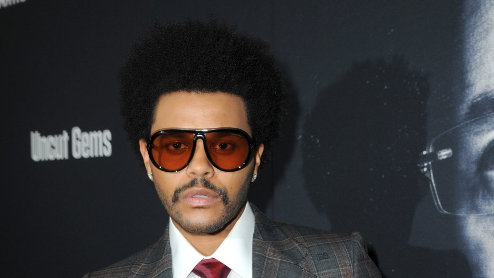The Weeknd wears sunglasses on red carpet