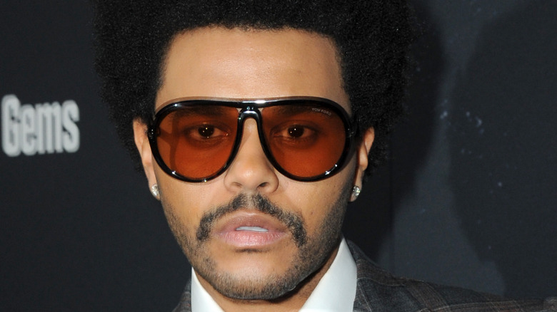 The Weeknd with red shades