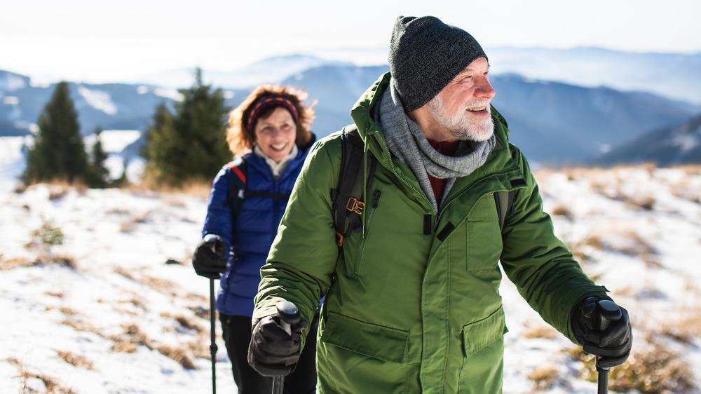 Couple walking mountain in winter