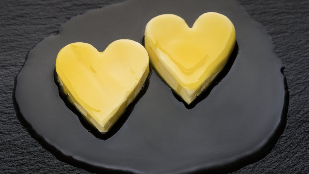 High cholesterol butter melting in a heart