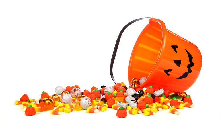 Pumpkin bucket spilling Halloween candy