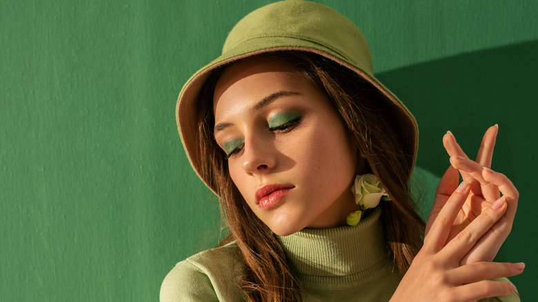 Woman with a green bucket hat