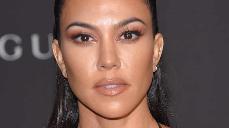 Kourtney Kardashian poses at an event