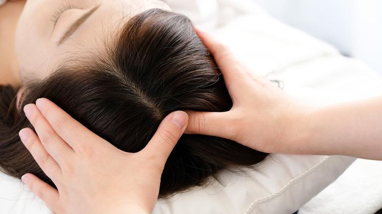Woman receiving acupressure