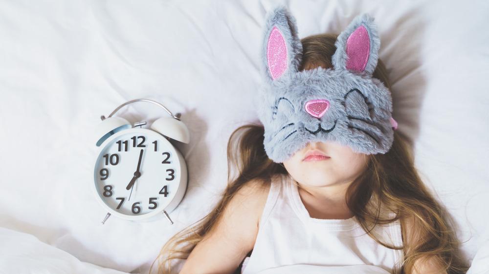 Girl sleeping with a sleep mask