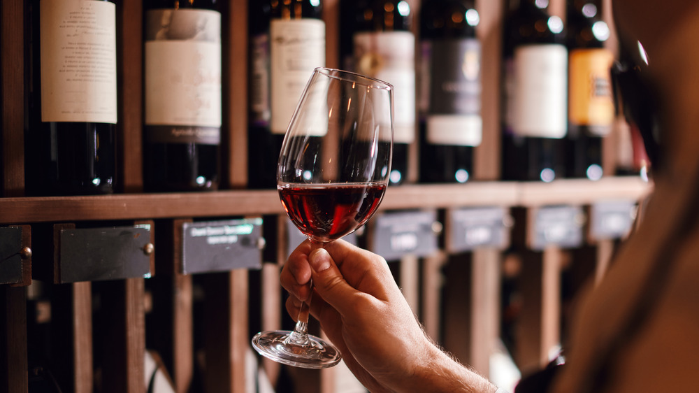 A man holding a glass of wine