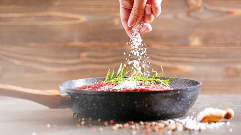 Person salting food