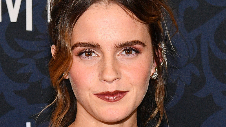 Emma Watson with slight smile and cat eye liner