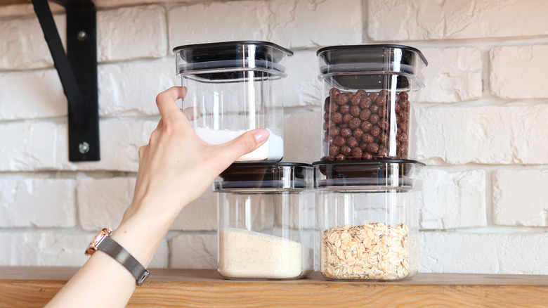 clear storage containers on kitchen shelf