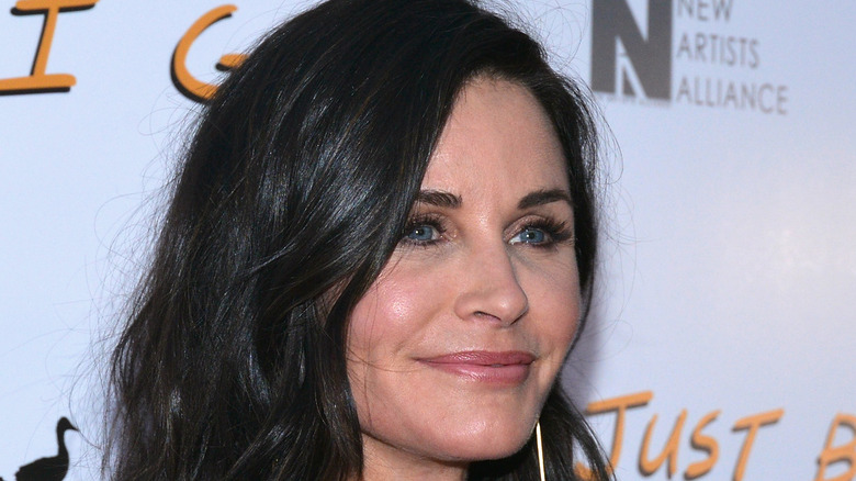 Courteney Cox smiling on red carpet
