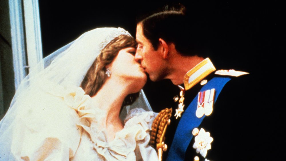Princess Diana and Prince Charles kissing on their wedding day