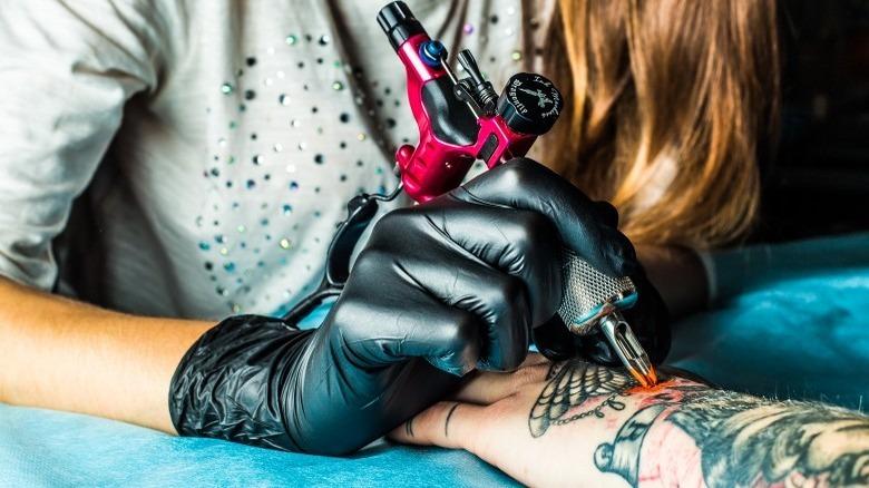 tattoo artist giving tattoo