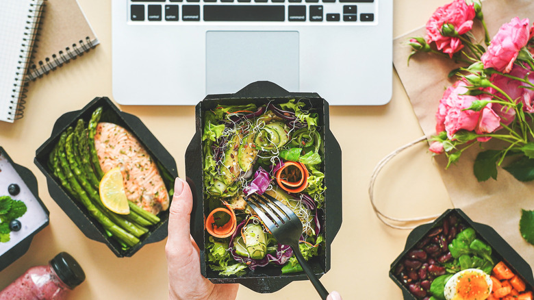Healthy lunch at the desk with a laptop