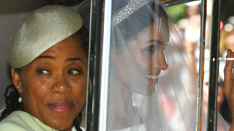 Meghan Markle leaves the Cliveden House Hotel accompanied by her mother, Ms Doria Ragland, ahead of her wedding to Prince Harry, 2018