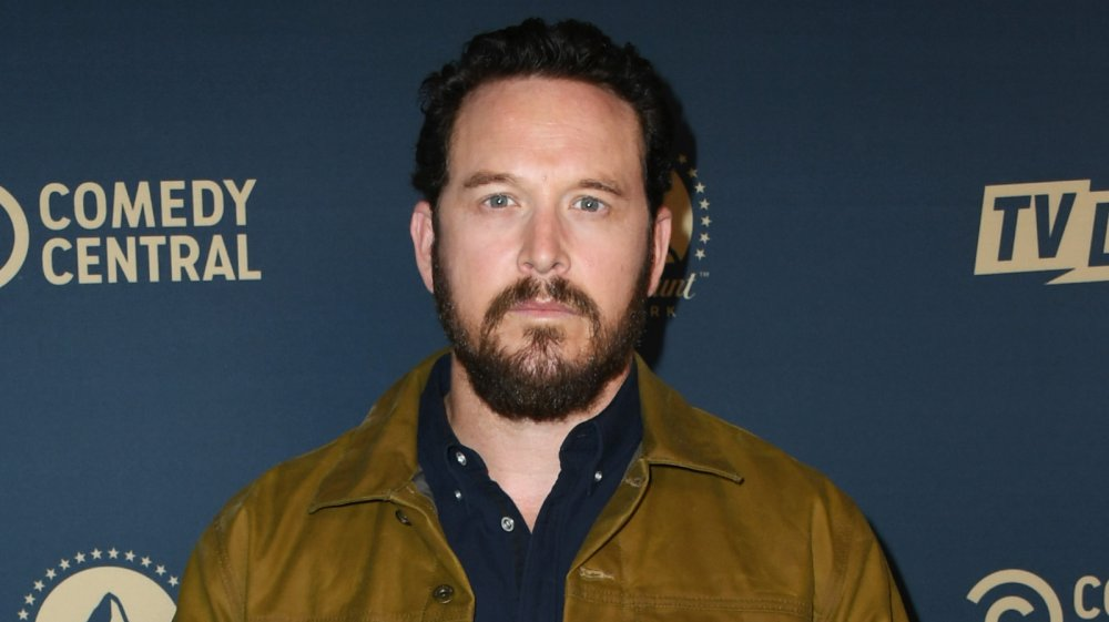 Cole Hauser posing with a neutral expression at a Comedy Central event