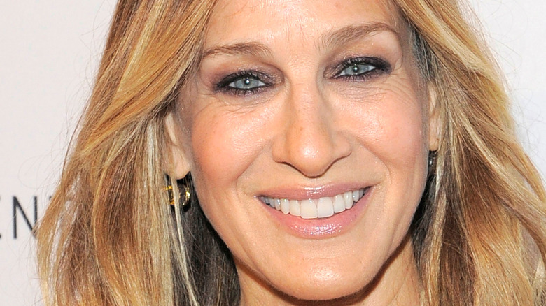 Sarah Jessica Parker smiles with straight hair