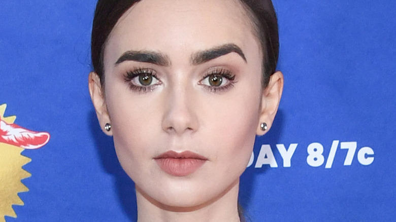 Lily Collins poses on the red carpet for the MTV Movie Award
