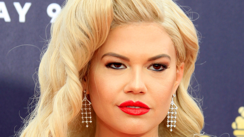 Chanel West Coast posing on red carpet