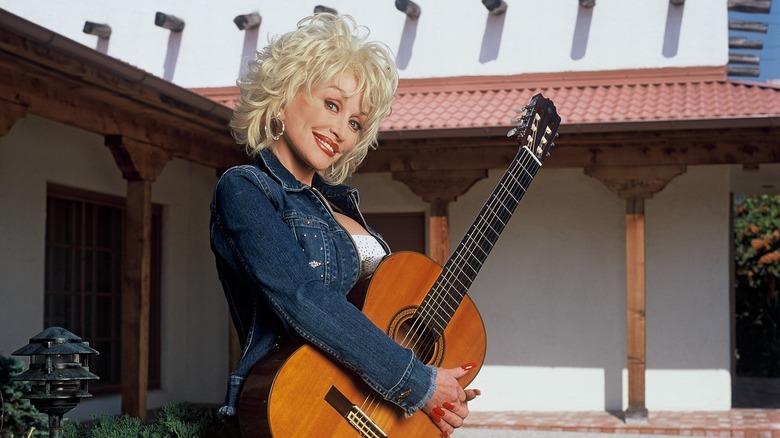 Dolly Parton with a guitar