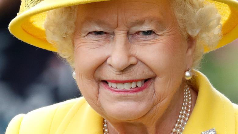 Queen Elizabeth smiling in yellow