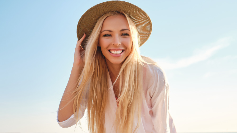 Blonde woman in hat smiling