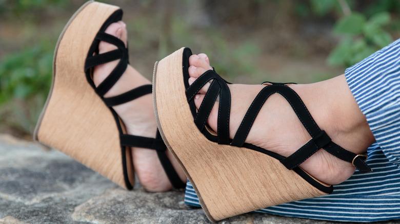 Woman wearing a pair of wedge sandal