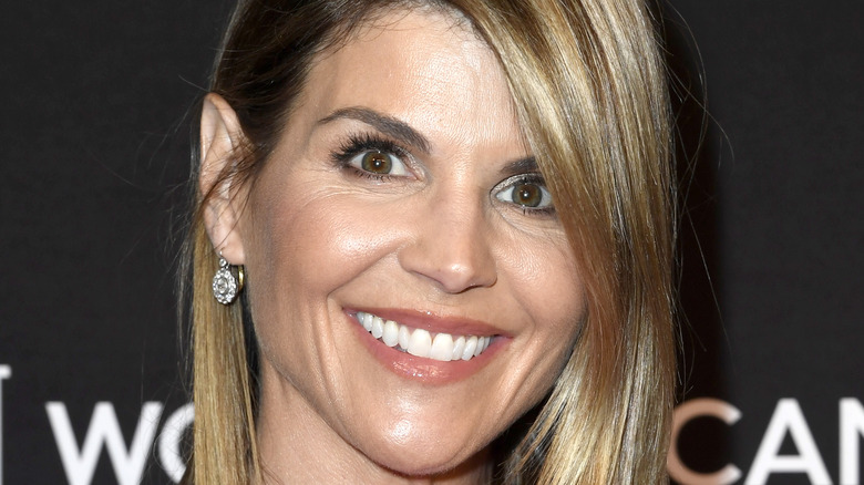 Lori Loughlin smiles on the red carpet.