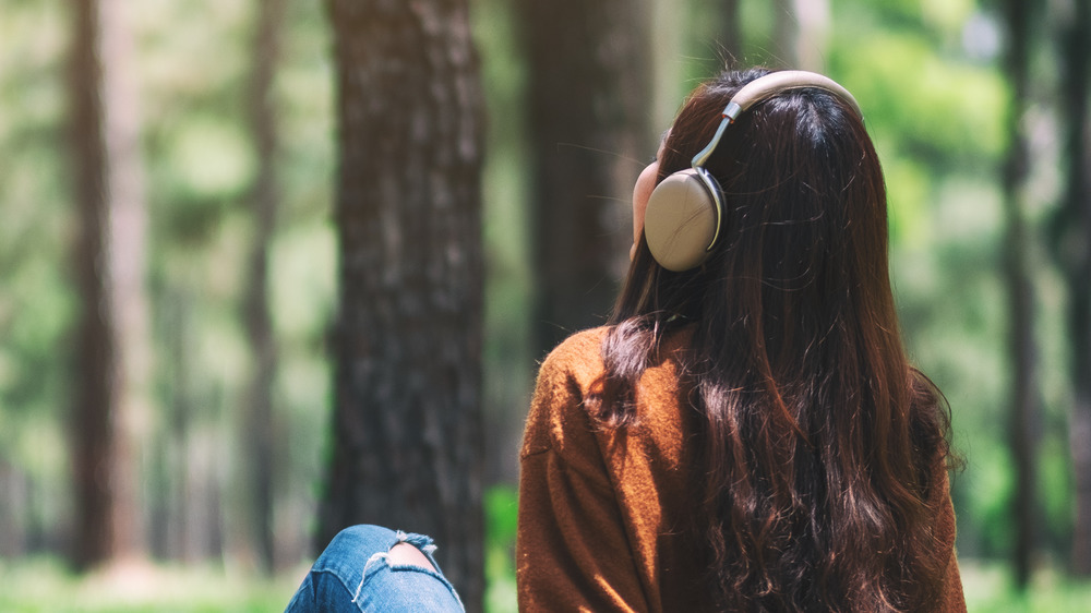 Woman in the park listening to music