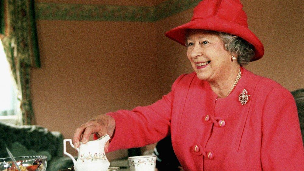 Queen Elizabeth of England drinks tea