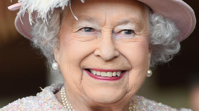 Queen Elizabeth smiles in pink
