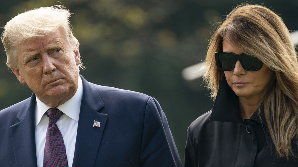 Donald and Melania Trump walk together