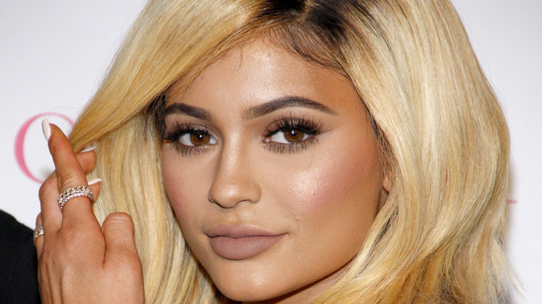 Kylie Jenner moving hair away from face