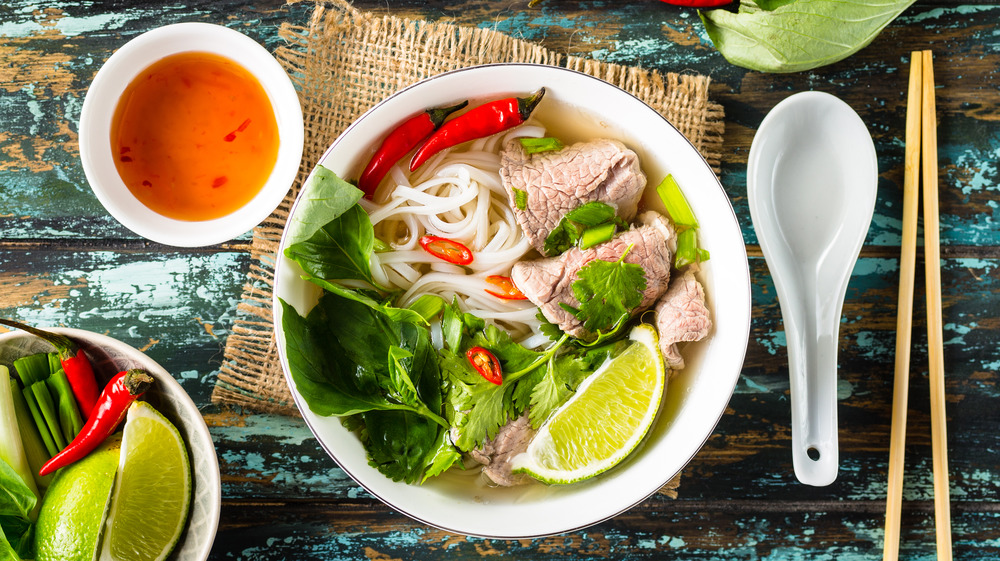 Bowl of pho on table