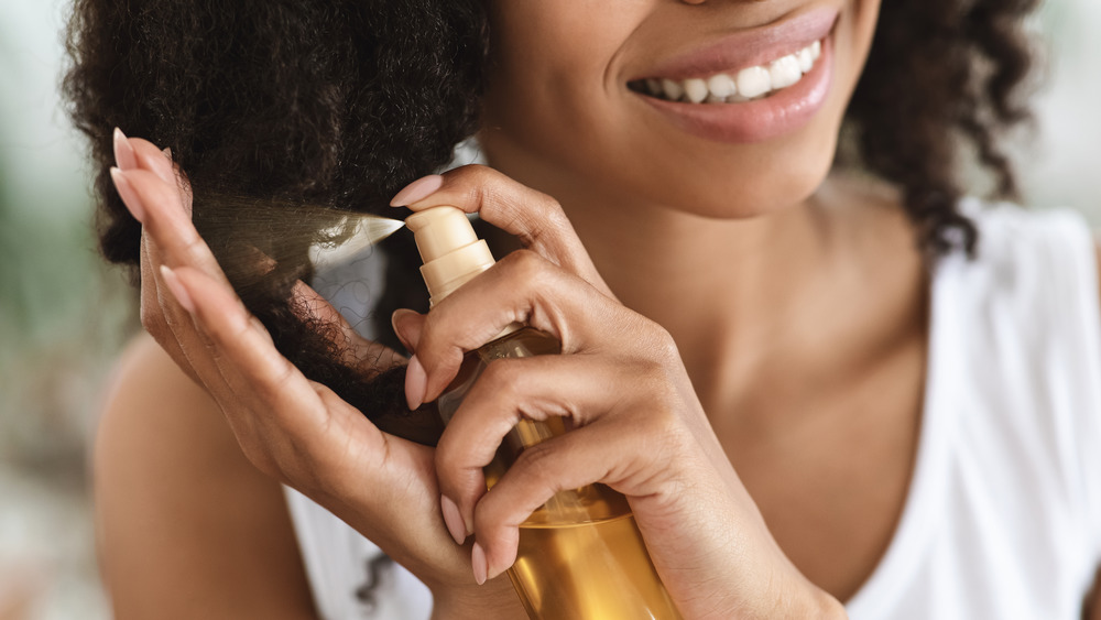 Woman applying hair product