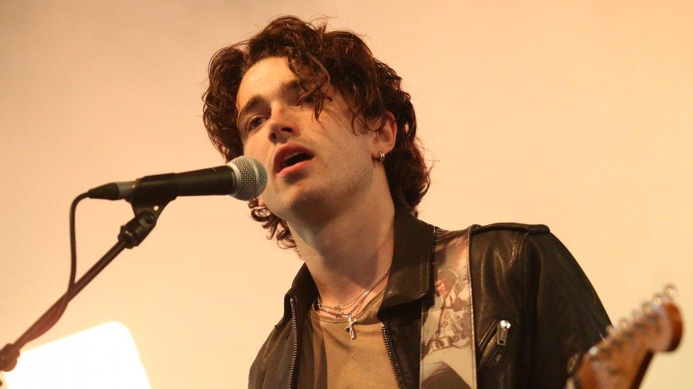 Bono's Elijah Hewson singing and playing guitar