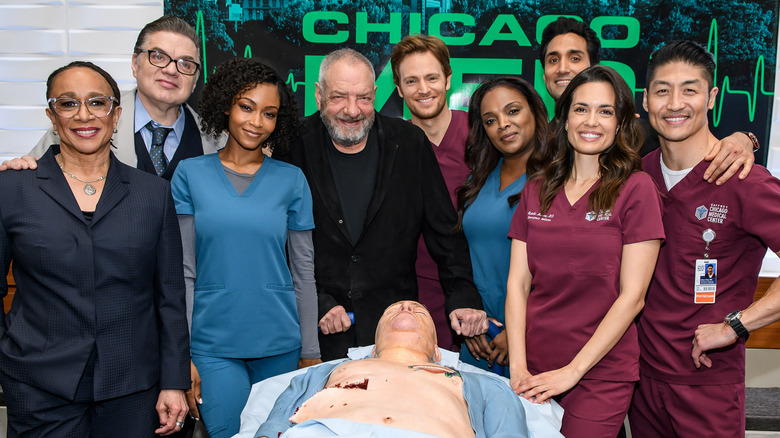 "Cast of ""Chicago Med"" celebrating 100 episodes with ""human"" cake"