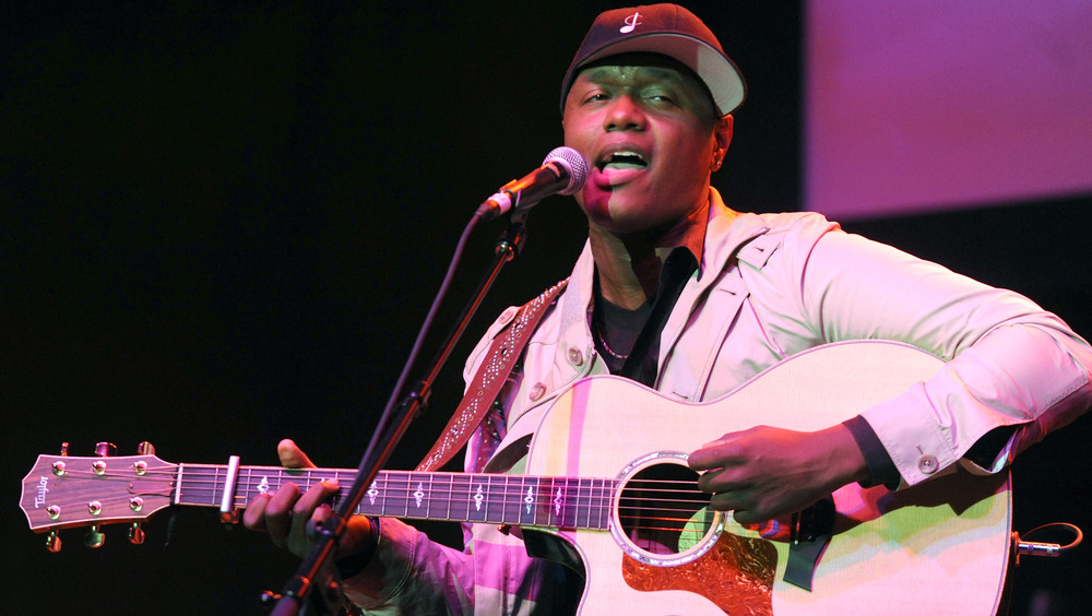 Javier Colon singing with guitar
