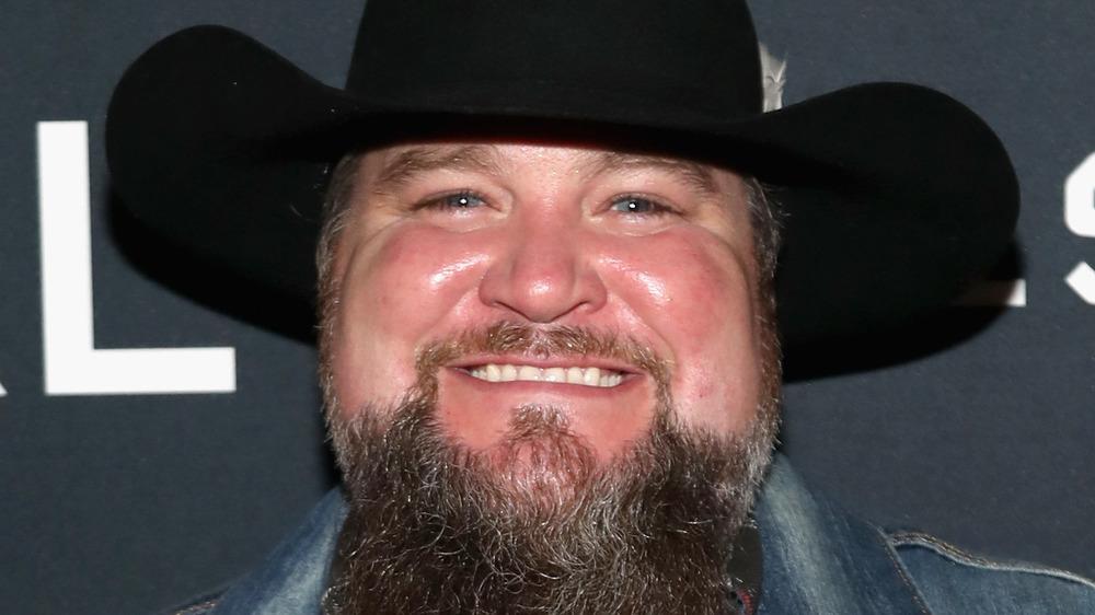 Sundance Head on red carpet in black cowboy hat