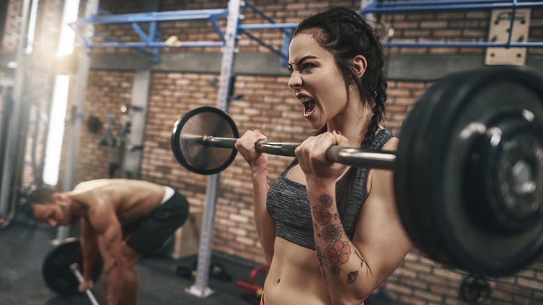 Fit woman lifting a barbell
