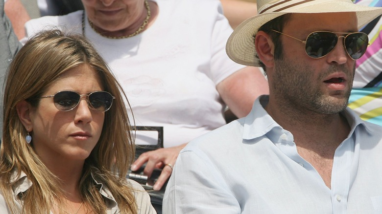 Jennifer Aniston and Vince Vaughn at a tennis match.
