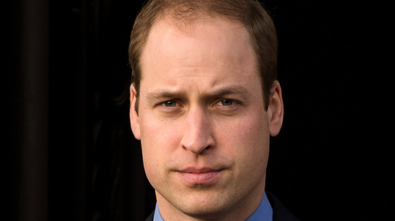 Prince William wears a suit.
